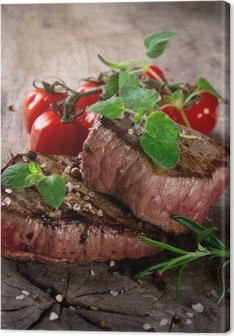 Grilled bbq steaks with fresh herbs and tomatoes Canvas Print