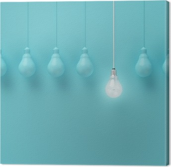 Hanging light bulbs with glowing one different idea on light blue background , Minimal concept idea , flat lay , top Canvas Print