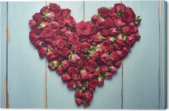Heart shape of roses on wooden background Canvas Print