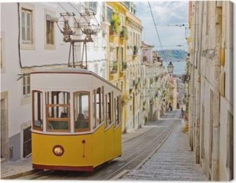 Historic tram on a street in Lisbon Canvas Print