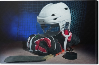Hockey gloves,helmet and stick lay on ice. Canvas Print