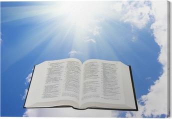 Holy bible in the sky illuminated by a sunlight Canvas Print