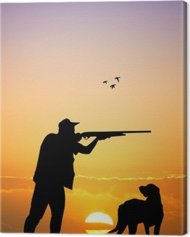 hunter with dog at sunset Canvas Print