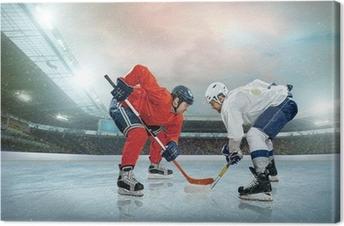 Ice hockey player on the ice. Open stadium - Winter Classic game Canvas Print