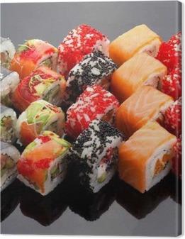 Japanese cuisine. Sushi set over black background. Canvas Print