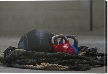 Kettle bells, rope and a medicine ball used for crossfit Canvas Print