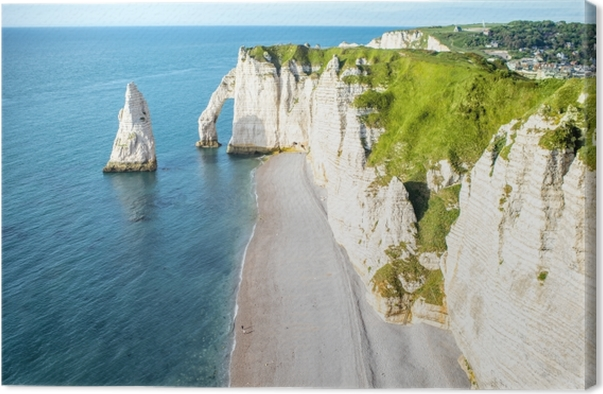 Landscape view on the famous rocky coastline near Etretat town in France during the sunny day Canvas Print -