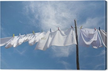 Laundry drying on the rope outside Canvas Print