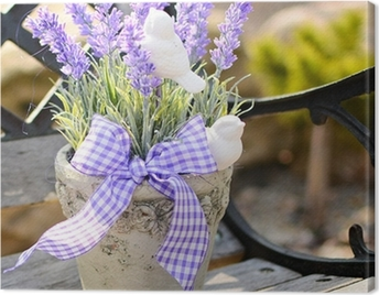 Lavender in the old pot on the bench. Home decoration. Canvas Print