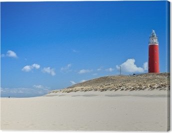 Lighthouse in the dunes at the beach Canvas Print