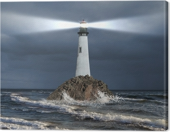 Lighthouse with a beam of light Canvas Print