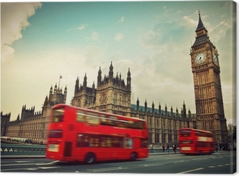 London, the UK. Red bus in motion and Big Ben Canvas Print