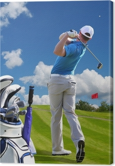 Man playing golf against blue sky with golf bag Canvas Print