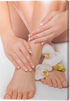 manicure and pedicure with white orchid. isolated Canvas Print