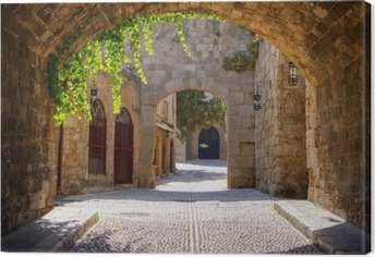 Medieval arched street in the old town of Rhodes, Greece Canvas Print