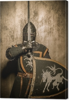 Medieval knight holding sword in front of his face Canvas Print