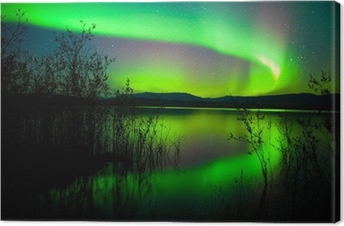 Northern lights mirrored on lake Canvas Print