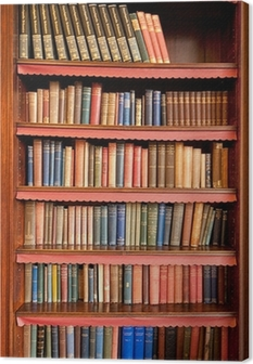 Old bookshelf with rows of books in ancient library Canvas Print