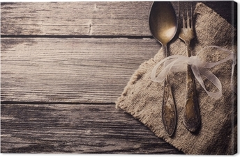 Old fork and spoon on wooden background Canvas Print