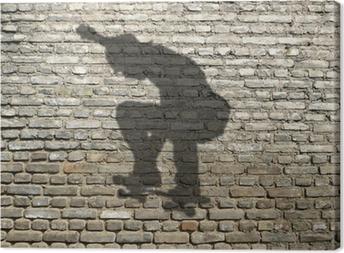 ombre de skate-boarder sur mur de briques Canvas Print