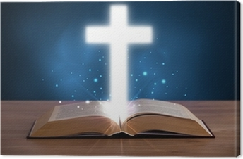 Open holy bible with glowing cross in the middle Canvas Print