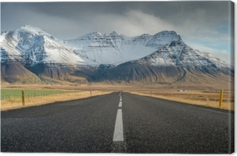 Perspective road with snow mountain range background in cloudy day autumn season Iceland Canvas Print