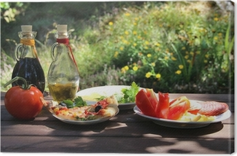Piece of pizza in the summer garden Canvas Print