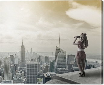 Pin-up woman watching New York City trough binoculars. Canvas Print