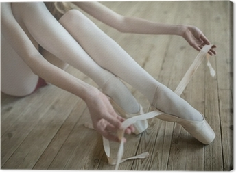 putting on ballet shoes Canvas Print