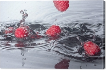 Red Raspberries Dropped into Water with Splash Canvas Print