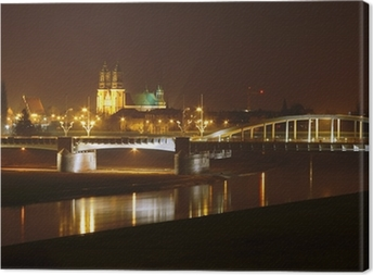 River Warta, bridge and cathedral at night in Poznan, Poland . Canvas Print