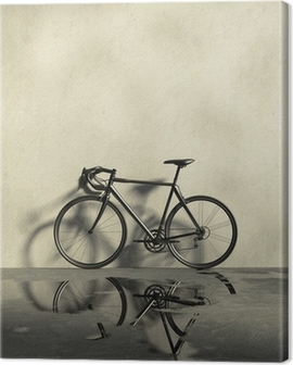 Road racing bicycle in a grungy, wet and dirt place Canvas Print