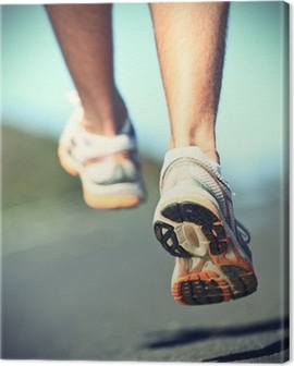 Runnning shoes on runner Canvas Print