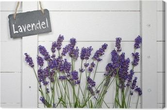 Schiefertafel mit Lavendel vor Holzwand Canvas Print