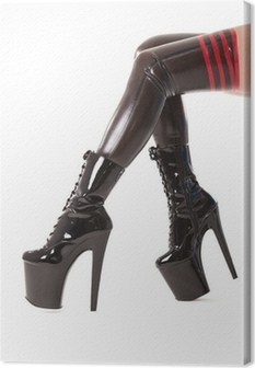 Sexy long legs in latex stockings and high heel boots Canvas Print
