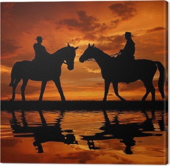 Silhouette cowboys with horses in the sunset Canvas Print
