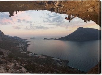 Silhouette of a rock climber at sunset. Kalymnos Island, Greece. Canvas Print