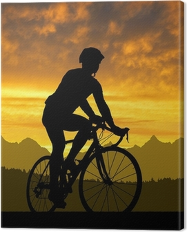 silhouette of the cyclist riding a road bike at sunset Canvas Print