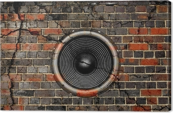 Speaker on a cracked brick wall background Canvas Print