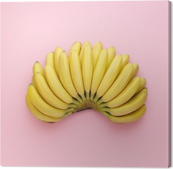 Top view of ripe bananas on a bright pink background. Minimal style. Canvas Print