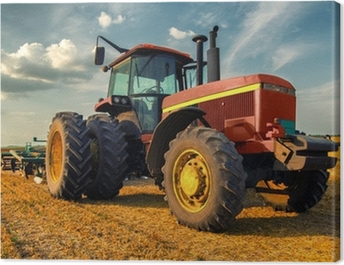 Tractor on the agricultural field Canvas Print