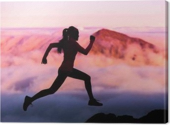 Trail runner nature landscape running woman silhouette on mountains background in cold weather with pink clouds at sunset. Amazing scenic view of peaks in altitude. Canvas Print