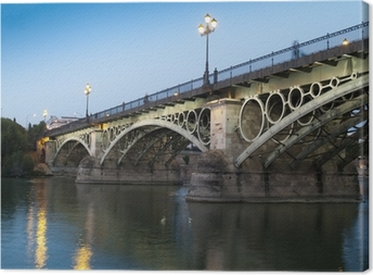 Triana Bridge, the oldest bridge of Seville at twilight Canvas Print