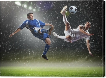 two football players striking the ball Canvas Print