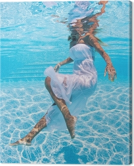 Underwater woman portrait with white dress in swimming pool. Canvas Print