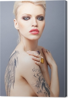 Vamp looking woman with tattoo wings on the back Canvas Print