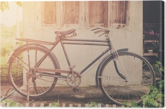 Vintage bicycle or old bicycle vintage park on old wall home. Canvas Print
