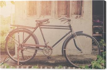 Vintage bicycle or old bicycle vintage park on old wall home. Canvas Print
