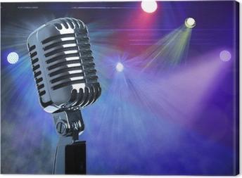 Vintage microphone on stage Canvas Print