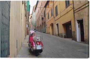 Vintage scene with Vespa on old street, siena, italy Canvas Print